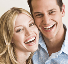 Smile couple after getting best dental treatment from Casey dental group